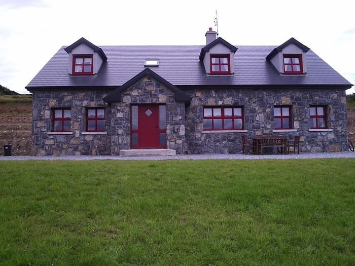 Limestone.Cladding.House.Red.Windows1.700.by.525