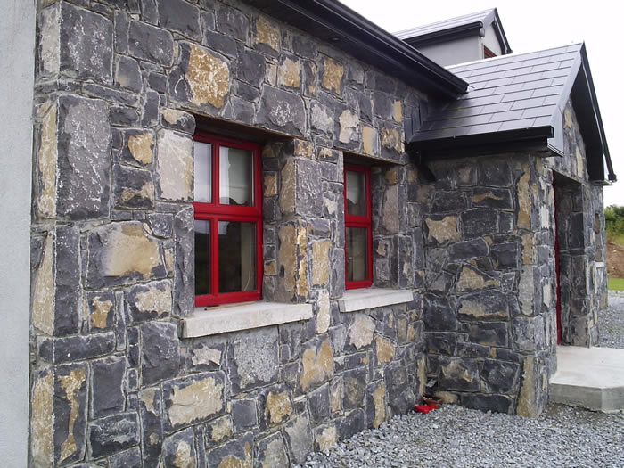 Limestone.Cladding.House.Red.Windows4.700.by.525