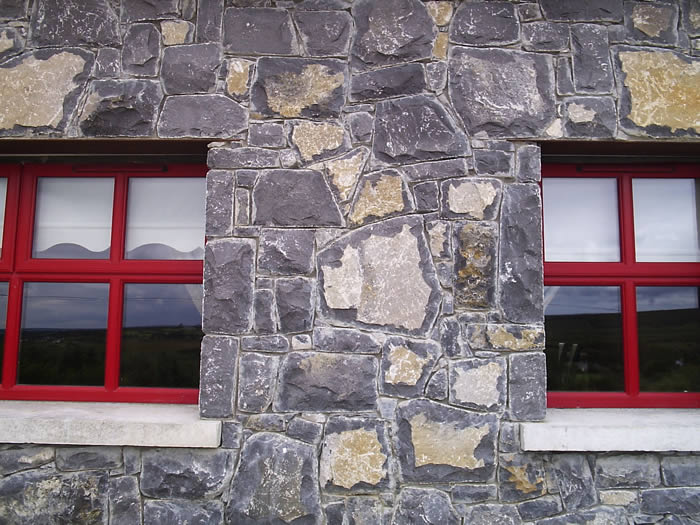 Limestone.Cladding.House.Red.Windows6.700.by.525